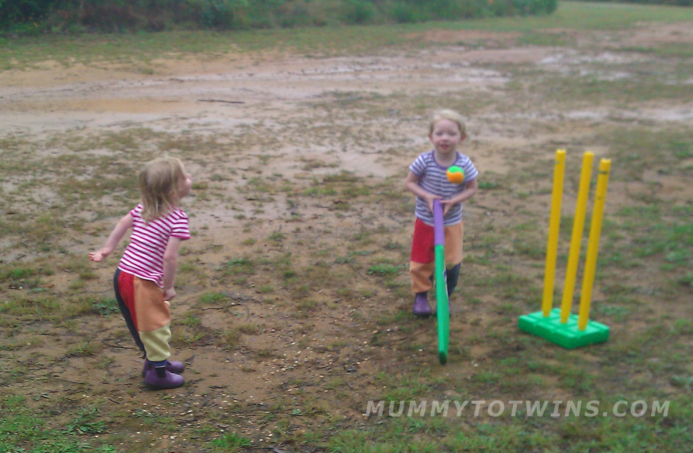 Julia and Lillian playing cricket