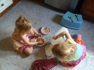 The girls making their own breakfast