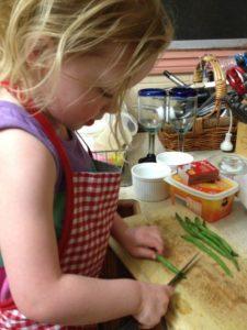 Julia cutting beans for dinner