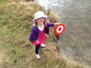 Julia playing in the lake