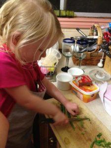 Lillian cutting beans for dinner