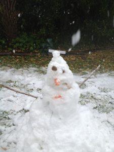 The girls first snowman