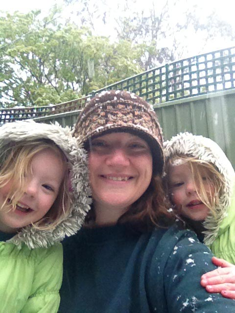 The girls and I experiencing snow in October of 2012.