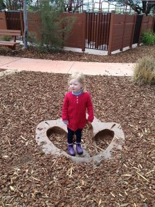 Julia in dinosaur footprint