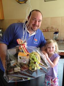 Daddy and Julia with his Interflora Hamper