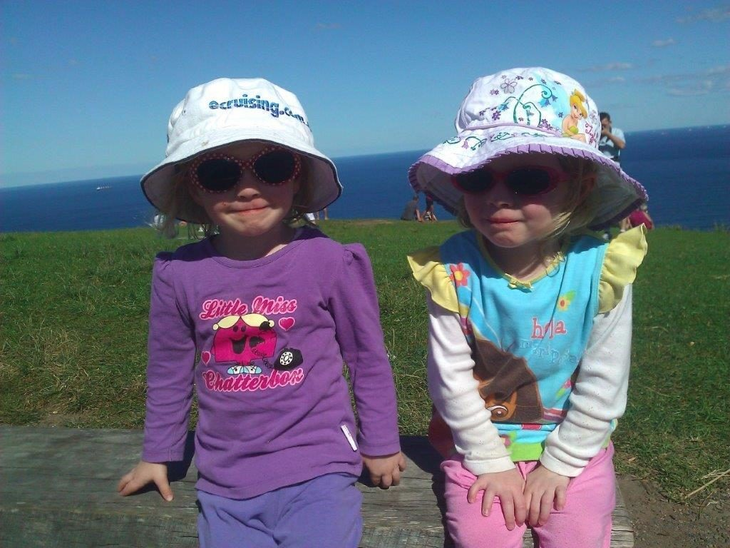 The girls about 3 years of age at Stanwell Tops with daddy.