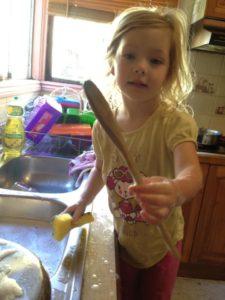 Julia washing up at home