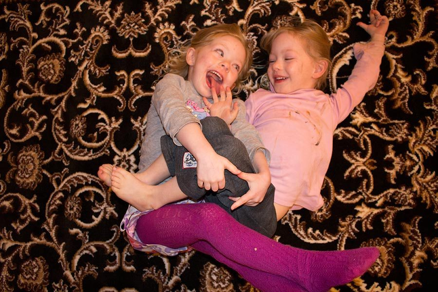 The girls being silly. This was in 2013, so they would have been about 5 years here.