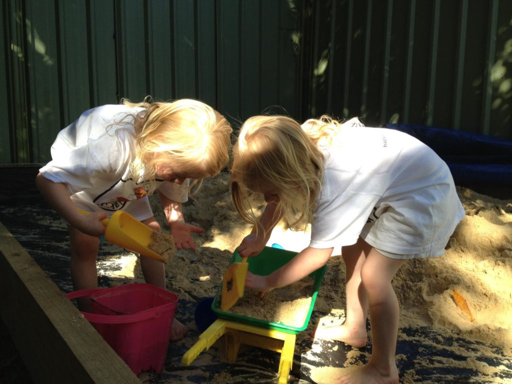 Kids happy with the finished product. A Sand Pit, Yes!