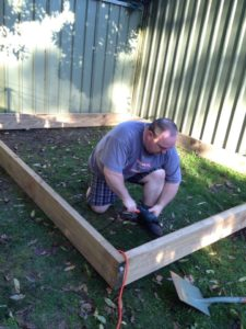 Hubby building the twins a sandpit