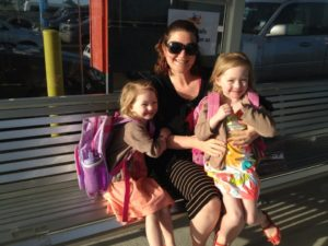 The girls and I waiting to get on airport shuttle