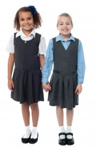 Girls getting ready to go to school.Image courtesy of stockimages at FreeDigitalPhotos.net