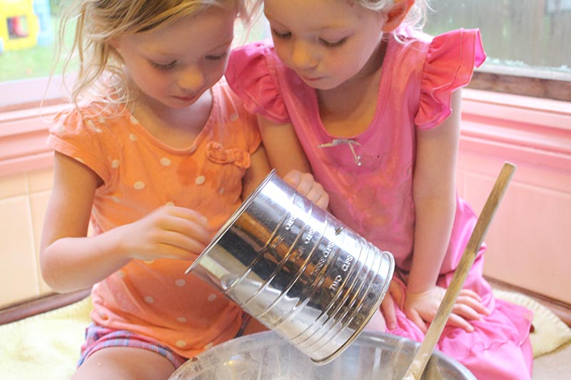 The girls sifting flour