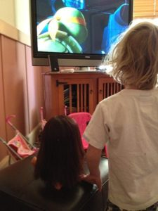 Dora and Julia watching the Teenage Mutant Ninja Turtles