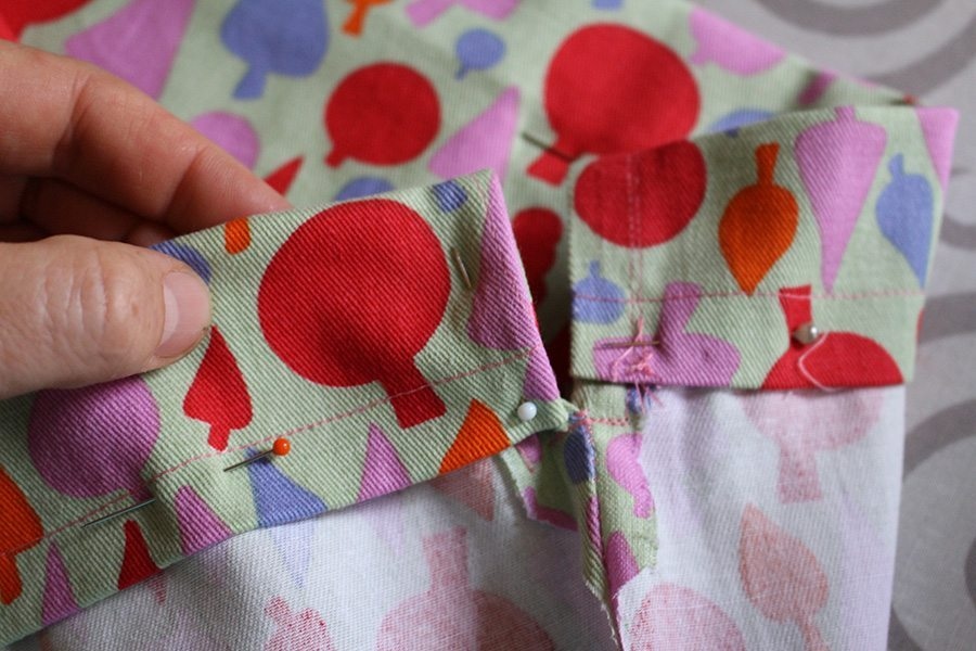 Sew around the edge to hold the top bit you folded over to be the casing. Make sure to join the gap so it holds but don't sew it closed.