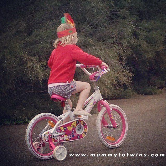 Julia racing away on her new bike. She is a very happy girl.