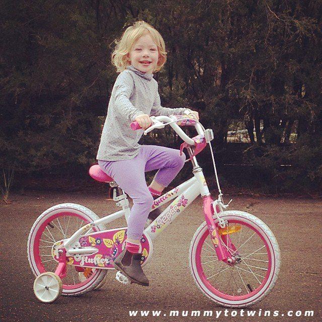 Lillian on her big girl bike. She is so happy!