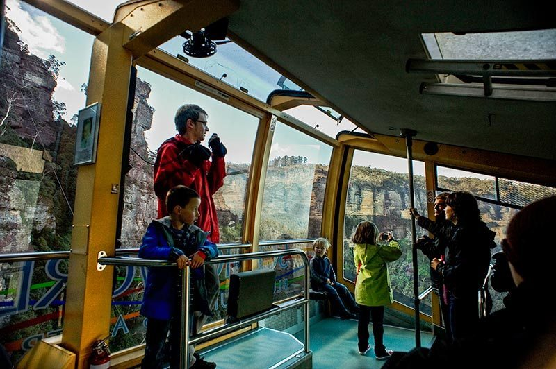 Scenicworld's Cableway cable car takes visitors through hanging swamps and lush mountain rainforests to climb up sheer rock faces with spectacular views of Katoomba Falls and the Jamison valley. Photo: Blue Mountains Lithgow & Oberon Tourism. Image by David Hill.