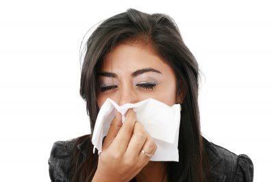 Sneezing due to allergies. Image courtesy of David Castillo Dominici / FreeDigitalPhotos.net