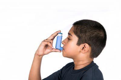 Child using asthma inhaler. Image courtesy of Arvind Balaraman / FreeDigitalPhotos.net