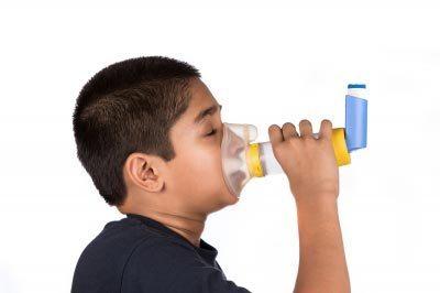 Thank god we have modern medicine! Child using asthma inhaler. Image courtesy of Arvind Balaraman / FreeDigitalPhotos.net