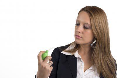 Woman using asthma inhaler. Image courtesy of patrisyu / FreeDigitalPhotos.net