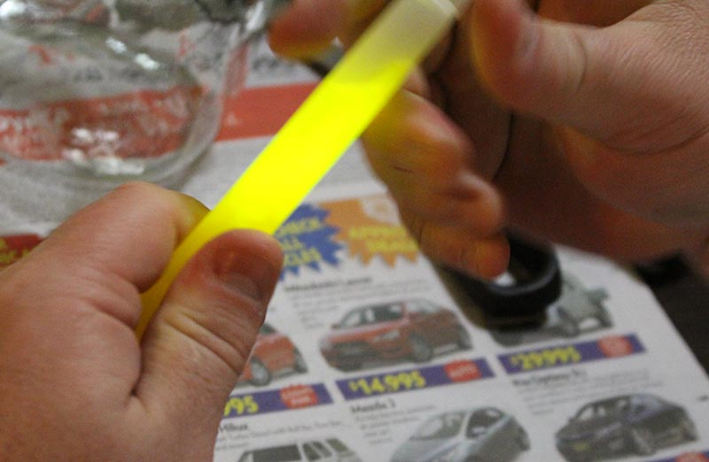 Activating the Glow Stick before cutting the top off it.