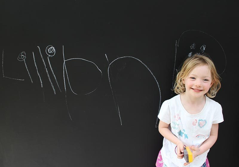 Lillian happy with her new blackboard.