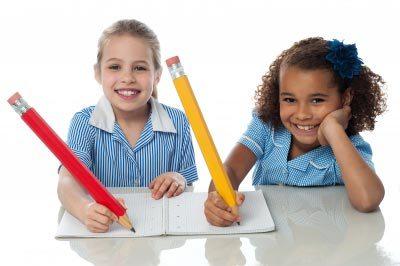 Kids working away with big pencils. Image courtesy of stockimages / FreeDigitalPhotos.net
