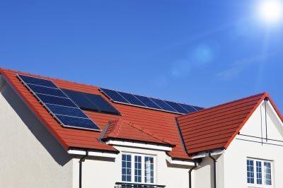 Making electricity, solar panels working in the sunshine! Image courtesy of Serge Bertasius Photography / FreeDigitalPhotos.net