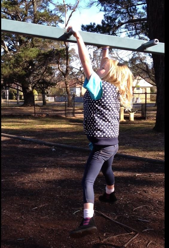 Look at me, I can do the monkey bars all by myself. How clever is she!