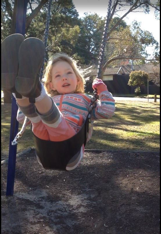 Swinging is fun! I am doing it all by myself now mummy!