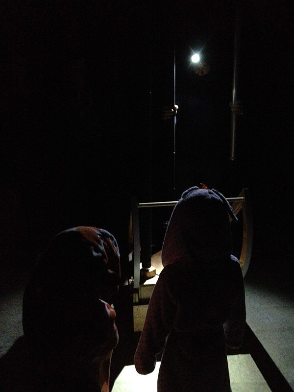 The girls waiting for the telescope to get set up. They were very curious about what the astronomer was doing.