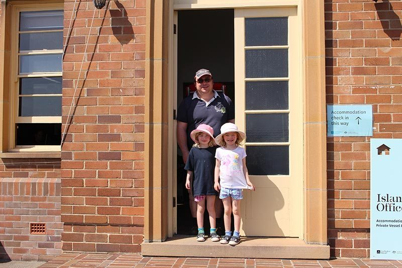 Hubby and the girls at the accommodation office on Cockatoo Island