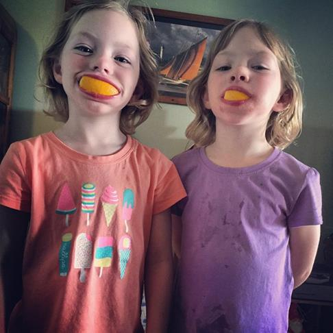 The kids cooling down with some fruit and being silly. They are having a great time on their holiday.