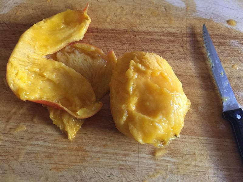 Chopping up fresh and very ripe mangoes