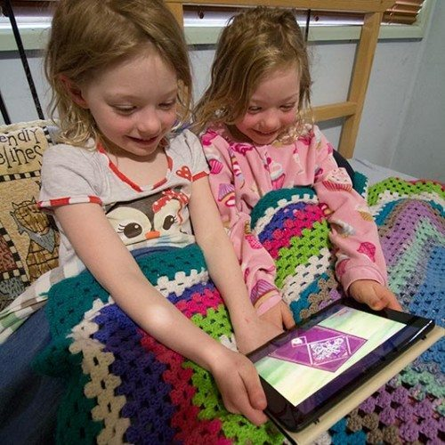 """The girls tucked into bed and all ready for a story from Disney Junior's """"The Book of Once Upon A Time"""""""