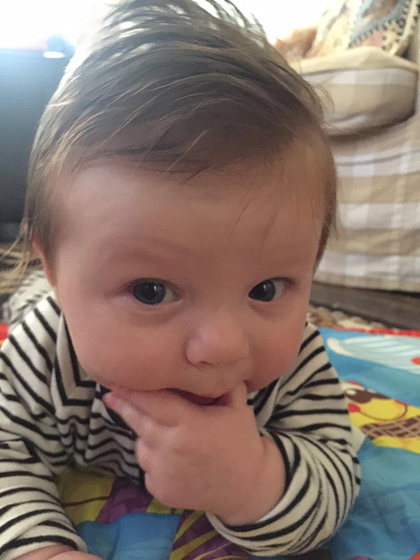 Alexander having tummy time and also to putting his hands in his mouth to soothe his gums. I just love his fab hair, it looks so stylish and funky.