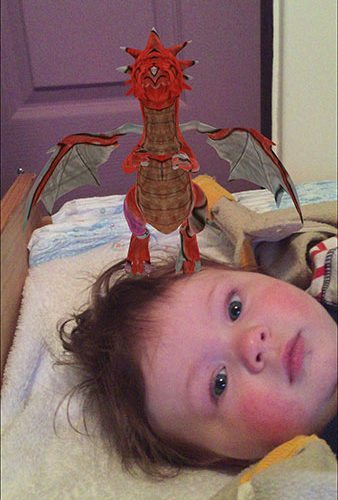 Even the baby had to have a selfie with the dragon.