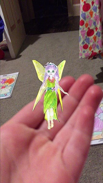 Creative shot of a fairy in one of the girls hands.