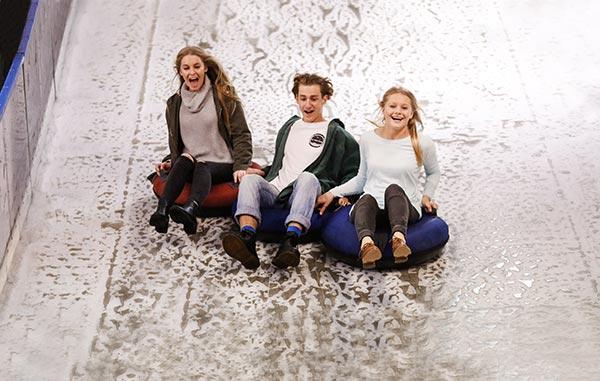 Having fun on the Real Ice Toboggan