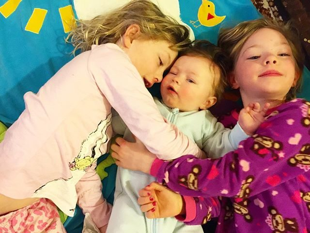 The girls love their baby brother.