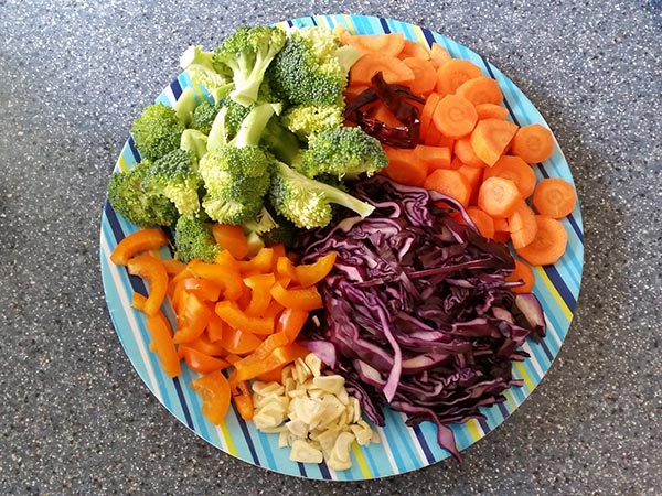 Brightly coloured and yummy vegetables ready to be added to the stir fry. YUM!