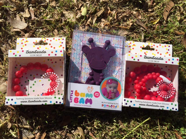 The Bambeado Silicone Bracelet, Bambeado Bam Bam Teething Toy and the Bambeado Silicone Necklace.