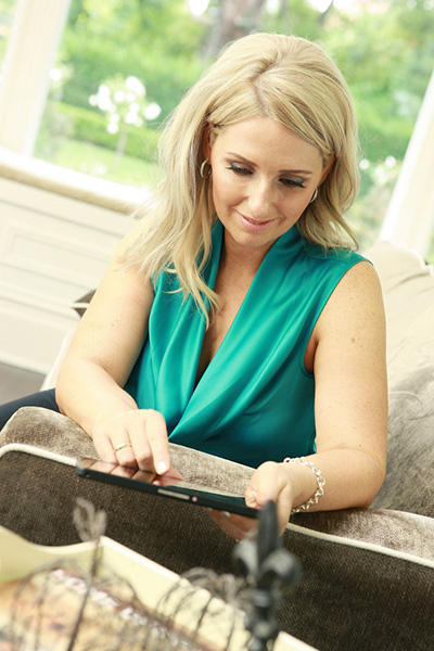 Intel Security's Cybermum Alex Merton-McCann using her device to be online.
