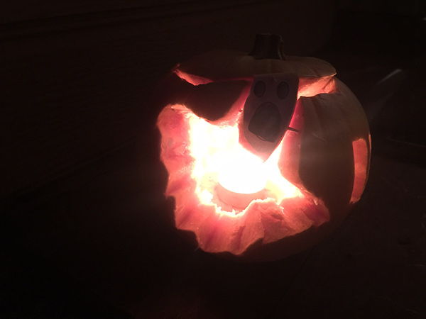 The ghost pumpkin with added head due to smaller pumpkin.