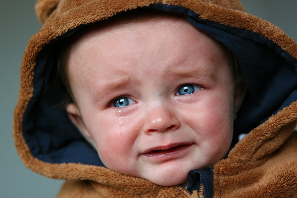 Baby upset. Not sure why. Could be the fact it is a new environment at playgroup.