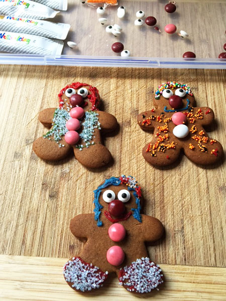 My decorated gingerbread people. Two are girls and one is a boy. I know it is hard to tell and my decorating skills need a bit of work. Don't they look pretty! Or festive to say the least.