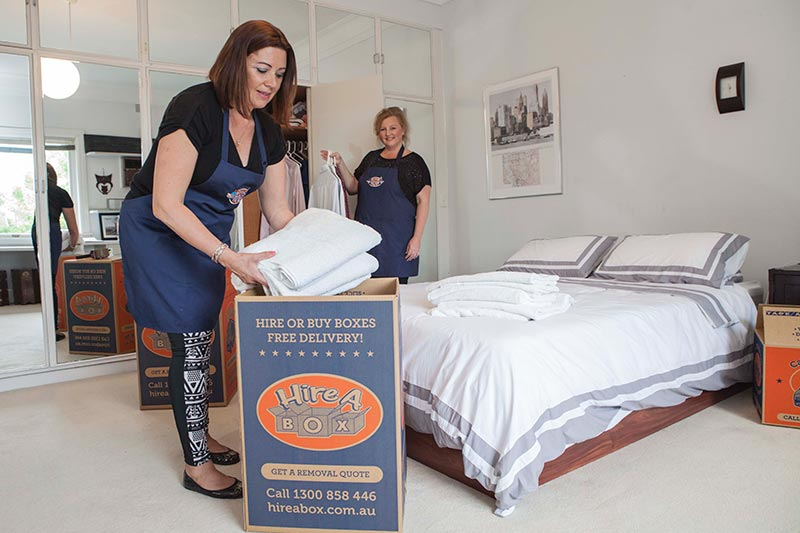 The lovely team at Hire A Packer packing up a bedroom.