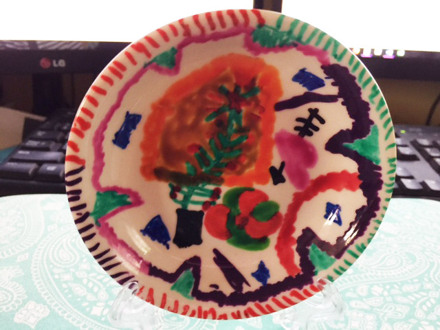 Plate decorated by Lillian. It is also sitting on my new laptop and case. What lovely presents I got this year.